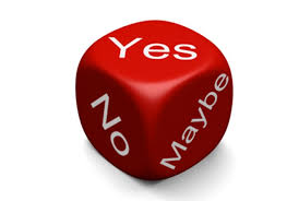 This is a picture of dice with yes no maybe on sides